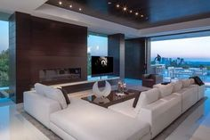 Luxury Living Area Design With White Sectional Couch And Modern Gas Fireplace Also Gray Rug And White Floor Tile: Strikingly Luxurious Laurel Way Residence in Beverly Hills White Sectional Sofa, Modern Sectional, Beverly Hills Houses, Family Room Design, Modern House Design, Luxury Living, Modern Living, Modern Family, Home Interior Design