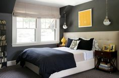 Idea: make the headboard much wider than the bed. Widens the area visually and leaves you free to buy a bigger bed later.