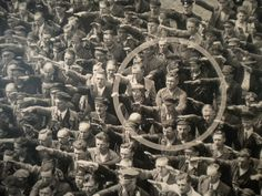 The courage to say 'No',   The photo was taken in Hamburg in 1936, during the celebrations for the launch of a ship. In the crowd, one person refuses to raise his arm to give the Nazi salute. The man was August Landmesser. He had already been in trouble with the authorities, having been sentenced to two years hard labor for marrying a Jewish woman.