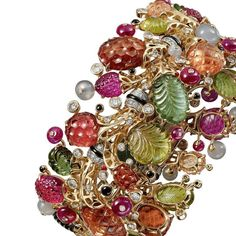 @Cartier Eclosion bracelet is bursting with sparkly joy in yellow & white gold with carved tourmalines, ruby beads, carved rubellites, carved peridots, moonstone beads, onyx and diamonds