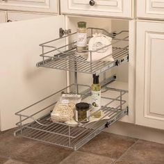 For organizing your appliances and accessories, choose this Rev-A-Shelf Blind Corner Cabinet Pull-Out Chrome Two-Tier Wire Basket Organizer. Basket Organization, Kitchen Cabinet Organization, Kitchen Storage, Organization Hacks, Kitchen Organizers, Cabinet Storage, Cabinet Drawers, Closet Storage, Kitchen Pantry