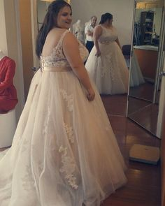 This backless plus size wedding gown has a pretty lace detail. The empire style waist is flattering. get info on custom #plussizeweddingdresses here. We can also make #replicas of couture #dresses for less too. So if you are a bride on a budget and have fallen in love with a dress out of your price range we can help!