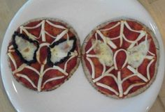 spiderman pizza pizza sauce on pita bread cut string cheese into strips to make the web cut out the eyes from the mozzarella slice, line eye with black olive pieces(optional)