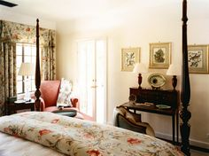 Kristi Nelson designed this traditional bedroom, featuring a stately four poster bed and classic floral pattern.