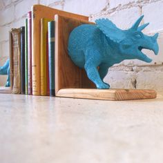 Awesome dinosaur bookends - Home Decor - Triceratops Pinned for Kidfolio, the parenting mobile app that makes sharing a snap.