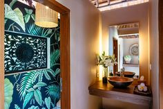 Looking for Tropical Bathroom ideas? Browse Tropical Bathroom images for decor, layout, furniture, and storage inspiration from HGTV. Green Bookshelves, Style Tropical, Traditional Benches, Tall Glass Vases, Palm Leaf Wallpaper, Cove Lighting, Lighting Ideas, Lighting Design, Powder Room Design