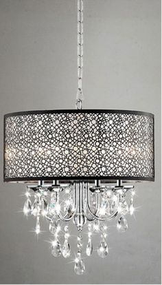 Add elegant and timeless style to your home with this four-light chandelier. Its interesting combination of chrome, metal and crystal make it perfect for both contemporary and traditionally designed h