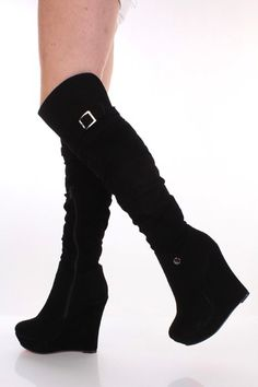 This very adorable wedges boot is a must have! Featuring faux suede, knee high, buckle strap accent cuff, single round stud detail, round close toes, light ruched, wrap platform heels Insole with faux leather lining, lightly cushion foot-bed, out-sole with rubber traction. Approx 5 inch heels 1 inch platform. Circumference measure at underneath cuff hem approx 14 inches. Shaft from back of top heels to top trim approx 18 1/2 inches