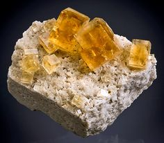 Gemmy cubes of Golden-Brown Fluorite and Celestite on matrix