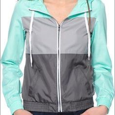 Zine Mint and Grey Colorblock Windbreaker •Zine windbreaker jacket for women. •Mint, Light Grey and Charcoal Grey colorblock design. •Adjustable drawstring hood. •Elastic waistband and sleeve cuffs. •Exposed zipper front closure. •Two front pockets. •Lightweight material. •Unlined. •100% polyester. Zine Tops Sweatshirts & Hoodies