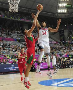 Anthony Davis of the U.S, right, shoots over Mexico's Gustavo Ayon during Basketball World Cup Round of 16 match between United States and Mexico at the Palau Sant Jordi in Barcelona, Spain, Saturday, Sept. 6, 2014. The 2014 Basketball World Cup competition will take place in various cities in Spain from Aug. 30 through to Sept. 14. (AP Photo/Manu Fernandez)
