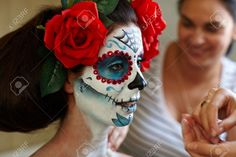 32468961-Makeup-artists-in-work-making-a-Halloween-makeup-mexican-Santa-Muerte-mask--Stock-Photo.jpg (1300×866)