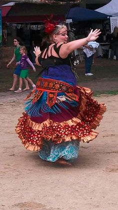 Lirima of Rockingham, NC dancing at a festival in Raleigh, NC. (plus size belly dance <3)