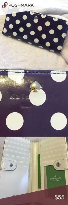 Kate Spade Plum Polka Dot Wallet NWT NWT Kate Spade plum colored polka dot wallet. Is in good condition with no scuffs or scratches. There is a small scratch on the Spade on the front of the wallet. Has original tag and has never been used. Holds 11 cards plus your ID. Has slots for receipts and cash. Back of wallet has zipper for change. Measurements are approximately 4 inches tall, 7 inch long, 1 inch thick. Feel free to ask any questions! kate spade Bags Wallets