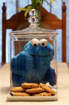 "Cute idea to display a Cookie Monster plush stuffed animal in a clear cookie jar, with the cookies outside of it on a plate for guests! ... ""Sometimes me think, what is friend? And then me say a friend is someone to share last cookie with."" ~Cookie Monster ... #SesameStreet"
