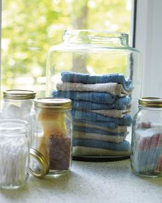"See-Through Storage  Clear glass Mason or spaghetti-sauce jars serve as convenient receptacles for cotton swabs, bandages, soap bars, and other bathroom necessities. ""When you're in a rush to get ready,"" says Seo, ""it helps to be able to see what's inside."" Cost: $0"