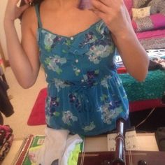 Floral Babydoll Shirt Perfect for summer and spring ❤️ it's only been worn a few times but I've outgrown it! So cute to wear though. Ties in the middle of you want to make it smaller; same with the straps are adjustable Aeropostale Tops