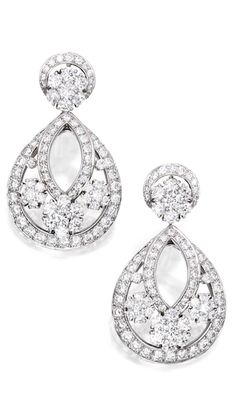 PAIR OF PLATINUM AND DIAMOND 'SNOWFLAKE' EARCLIPS, VAN CLEEF & ARPELS The openwork earclips of floral design, set with round diamonds weighing approximately 7.15 carats, signed Van Cleef & Arpels, numbered mu 2133.