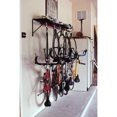 Not only can it hold bikes vertically, but once bikes are secured onto the rack, they can be rotated to fit flatly against the wall. You are left with more floor space, and the rack even includes an integrated mesh cloth hammock shelf for storing your helmets, gloves, and other biking gear.: