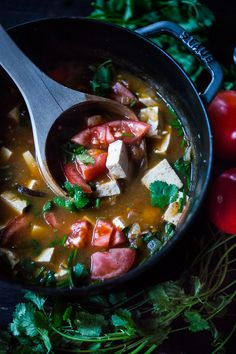 Vietnamese Hot and Sour Tamarind Soup with tomatoes, mushrooms, and tofu. This healing soup is gluten free and vegan!