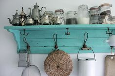 love the turquoise shelf to display a collection