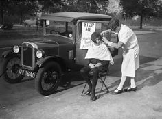 Mobile hair salon, England, circa 1920s. Customers just had to stop the car, then gave the haircut in place. That's how easy it is!