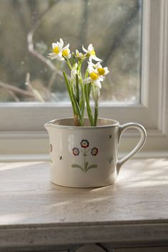Perfect for planting herbs or small flowering bulbs for indoor colour. Handmade and hand-painted.