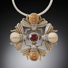 jewelry image of Sterling Silver, 14k Gold Fill, Garnet & Walrus Tusk Necklace  (Size:  1.5 in. tall x 1.5 in. wide)