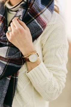white sweater with burgundy watch