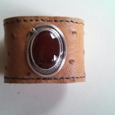 Carnelian set in silver on recycled leather cuff.