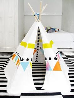 Goodness that is a cute teepee!  So graphic (especially against the rug) and I dig the colors.