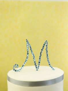 Rhinestone Monogram Cake Topper from The DIY Bride: 40 Fun Projects For Your Ultimate One-of-a-Kind Wedding.