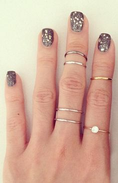 Sparkle nails + stacked rings