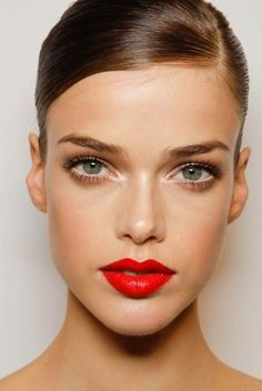Smooth hair, perfect skin, mascara and red lips