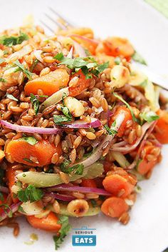 A hearty salad with rye berries, tender carrots, onions, cilantro, celery, and toasted Marcona almonds in a simple olive oil vinaigrette.