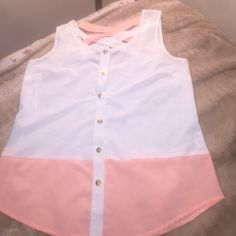 Very pretty summer tank top Peachy pink and white top with cross cross detailing on the back. Worn once. Came from a very high end boutique coliseum to my home town. Size small but probably could fit a medium MINE Tops Tank Tops