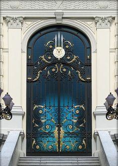Dark blue gold gilded door