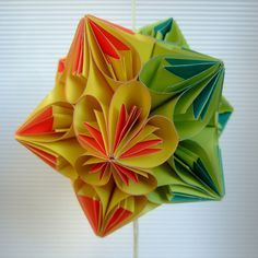 twisted kusudama 1 is the download link for the book page ornament. Very pretty for Christmas or this way.