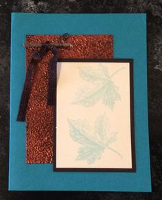 Entered in simonsaysstampblog.com  Embossing Monday Challenge.  Heat embossed rust card stock with copper UTEE.  Tied ribbon around twig, attached to panel with curled turquoise wire.  Stamped turquoise leaves on white scrap, matted on black scrap. Adhered all to card.