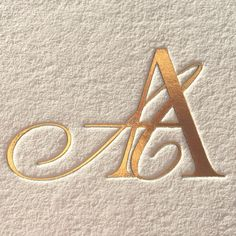 A modern take on a double-letter monogram foil-stamped in gold into pillowy 100% European cotton paper for a very discerning couple. #MonogramMonday