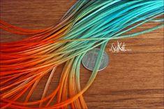 . Orange and aqua teal ombré hair