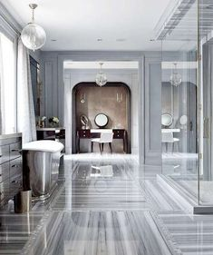 Splendor in the Bath. Grey marble, grey walls, mirrored cabinets