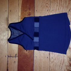 Lululemon top size 2 EUC!! This is a lululemon size 2 gray EUC top. The size tag is cut off, however this is mine and it is size 2. The back top is black mesh. Open to offers!! lululemon athletica Tops Tank Tops