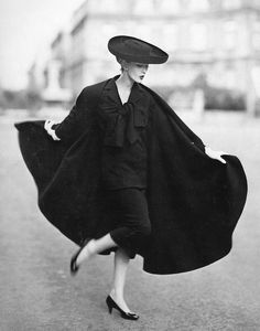 Dovima in cape ensemble by Lanvin-Castillo, photo by Avedon, Place Francois-Premier, Paris, August 1955