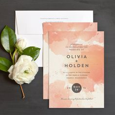 I love the combination of grey and blush-shaded pink on the invitations!