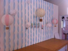 Up up and away party backdrop with hot air balloons. I still want to have one of my daughter's birthday themes be a vintage hot air balloon party!