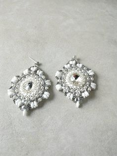 Check out this item in my Etsy shop https://www.etsy.com/listing/524994233/silver-white-bridal-earrings-dangle