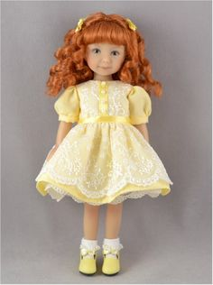 Sweet looking doll with a yellow dress.  Hair is red with two yellow hairbows on each side.