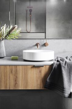 Concrete-look tiles and tapware from Astra Walker create a sleek and stylish bathroom in this energy efficient Melbourne home. Bathroom Renos, Laundry In Bathroom, Bathroom Inspo, Bathroom Colors, Bathroom Faucets, Bathroom Inspiration, Bathroom Interior, Modern Bathroom, Bathroom Ideas
