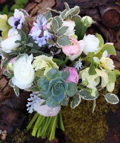 April seasonal bouquet of British flowers with ranunculus, blue bells, anemone and echeverria.  by Tuckshop Flowers, Birmingham.